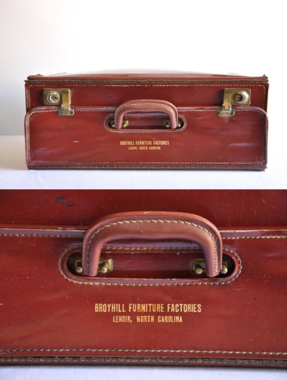 This gorgeous piece of luggage is a vintage brown leather salesman briefcase from Broyhill Furniture Factories.  Broyhill Furniture Industries, Inc., grew out of the Lenoir Chair Company, founded in 1926 by James Edgar Broyhill in Lenoir. A slump in furniture sales in the 1940s and 1950s caused Broyhill to make changes. These included a paid sales staff, modernized factories, the production of more expensive and stylish products, quality control, national advertising, and the production of…