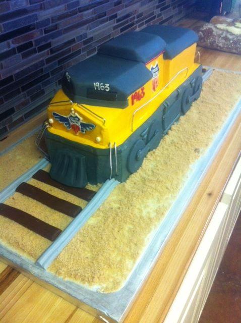 3D train cake on the railroad
