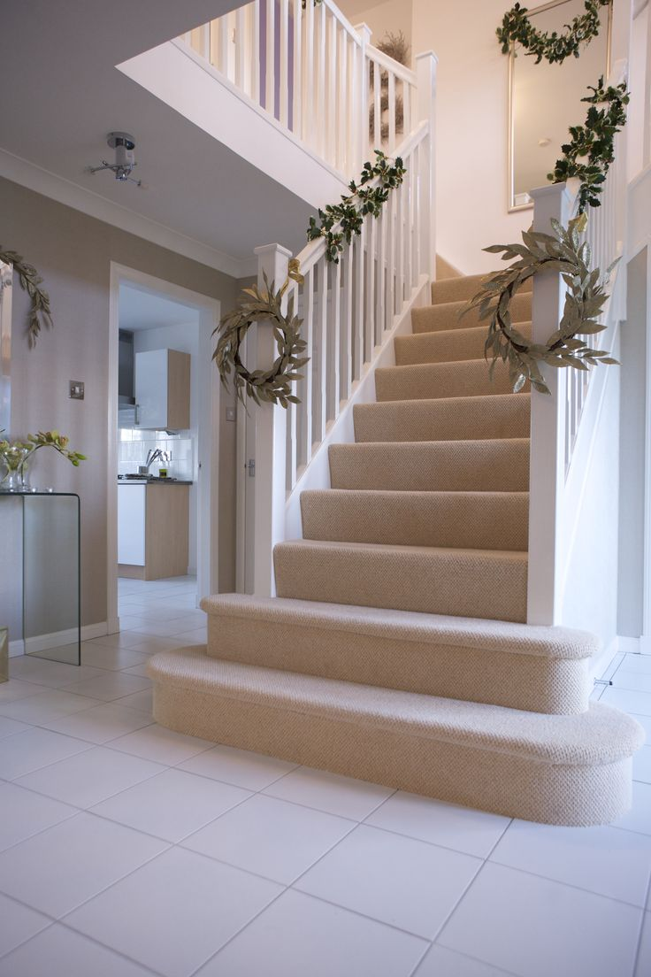 Modern Christmas tree branches decor on white stair inside ...