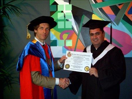 Luis Pereira receiving his degree from Prof. Dr. William Martin, BIU CEO