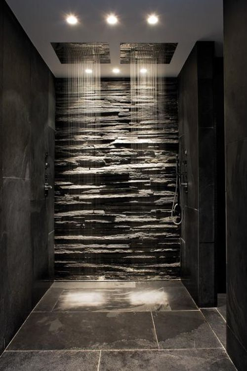 The stone in this...have a trickling waterfall that always runs down it in the shower, even when not showering.