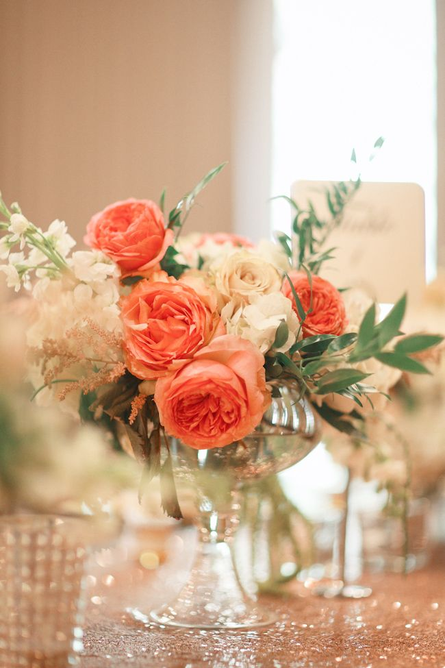 Peach and Ivory centerpieces with Blush Sequin linen