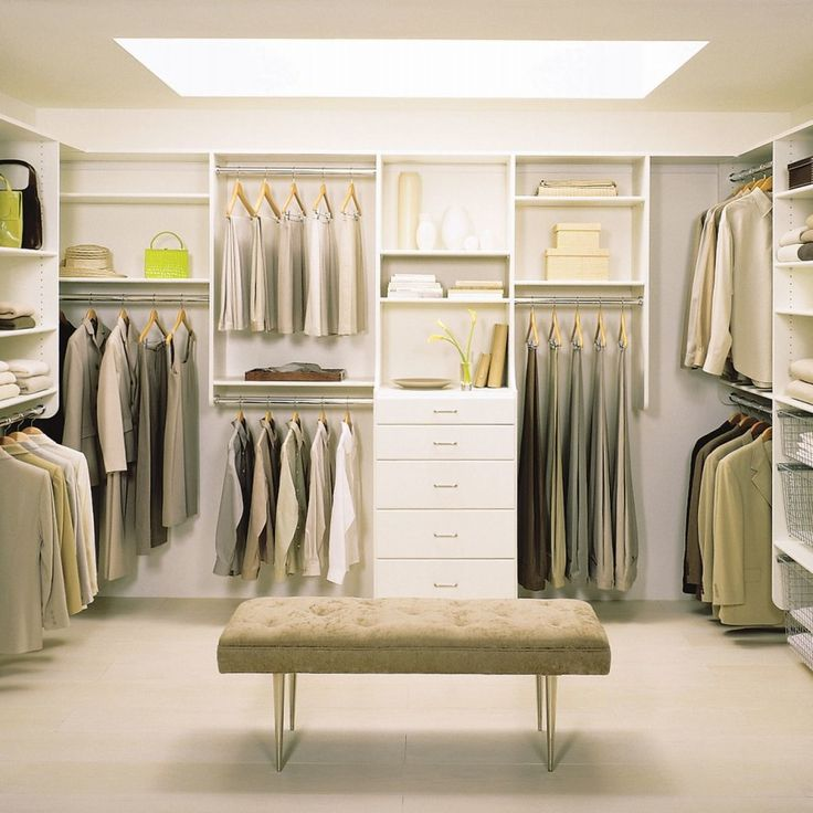 Luxury Walk-in Closet Pictures For Inspiration : Marvelous Luxury Walkin Closet Design with Beige Seat Pad Rectangular Pouffe and Simple Side Cloth Hanger also Five White Drawer