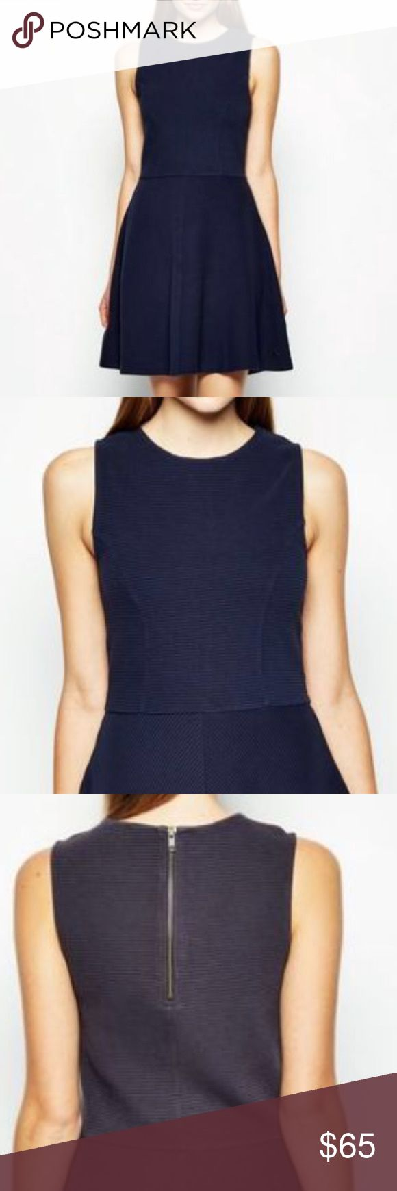 Jack Wills Dawsmere Navy Dress, US 6. New w/o tags Jack Wills Dawsmere Navy Dress, UK 10 US 6. New w/o tags.  designed to flatter. In a heavier weight soft fabric, the skirt flares out in skater style whilst the top is conservative and classy with a high neckline and tailored fit. It sits easily and comfortably with a zip fastening down the back - wear it with a structured blazer to keep things elegant. Jack Wills Dresses Mini