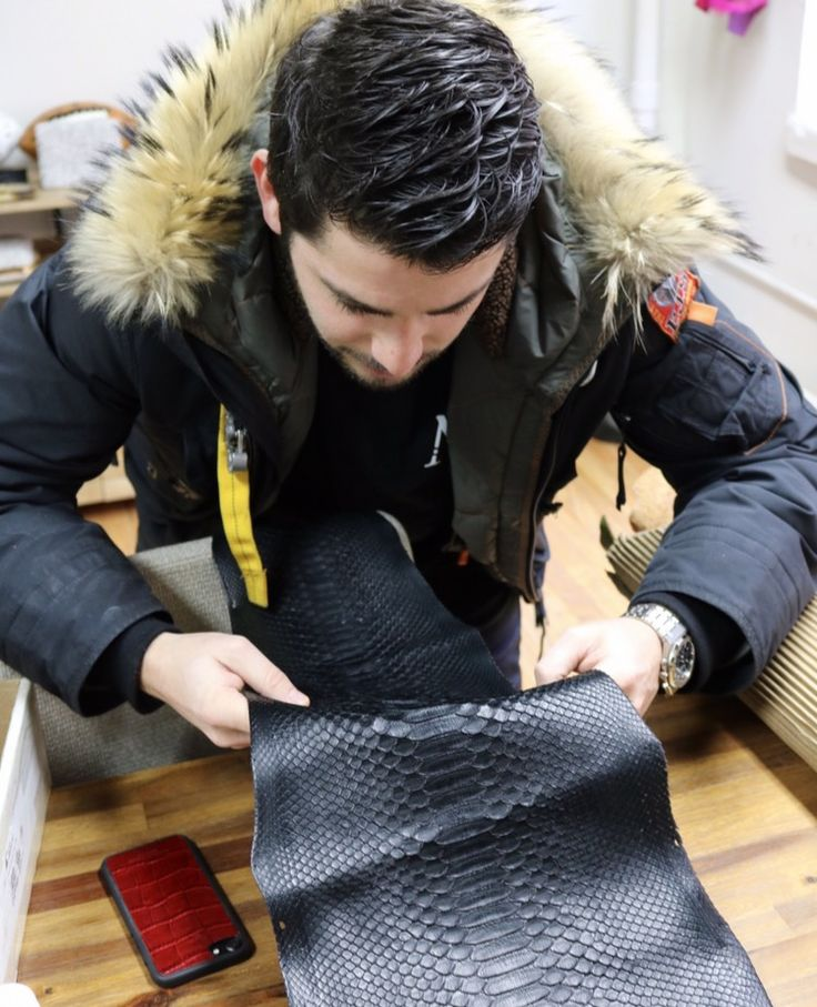 Inside the New York City factory, preparing black Python leather for production of the Michael Louis iPhone 7 & 7 Plus Case.  After Michael inspects and confirms the leather for production, the leather is then skived to the correct thickness, prepared to be cut, and then installed - each step of the process is done by hand.  Our Story + Behind The Scenes   #MichaelLouis - www.MichaelLouis.com