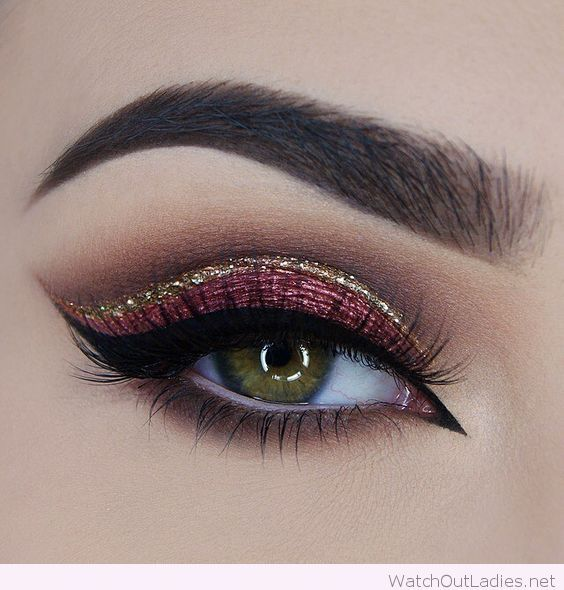 Pink and gold eye makeup with black eye line