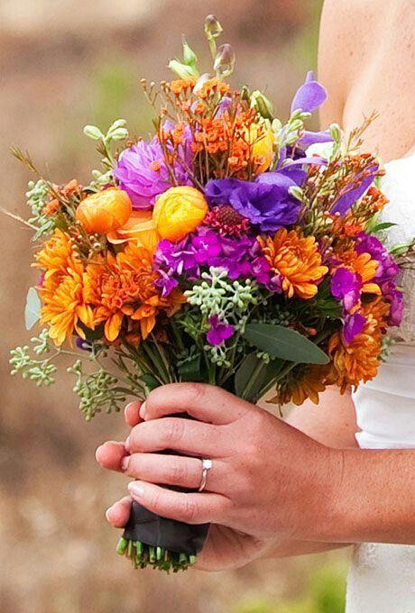 {Hand Tied Bride's Bouquet Featuring: Purple Lisianthus, Purple Chrysanthemums, Orange Chrysanthemums, Yellow/Orange Ranunculus, Fuchsia Filler, Green Seeded Eucalyptus, Orange Hypericum··········································}