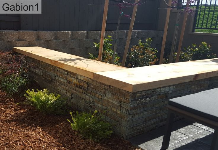 Gabion wall topped with timber slab for Gabion landscaping