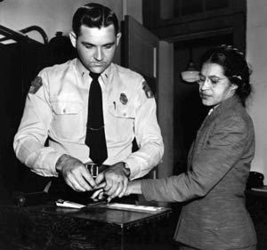 Rosa Parks being booked for refusing to give up her seat to a white man