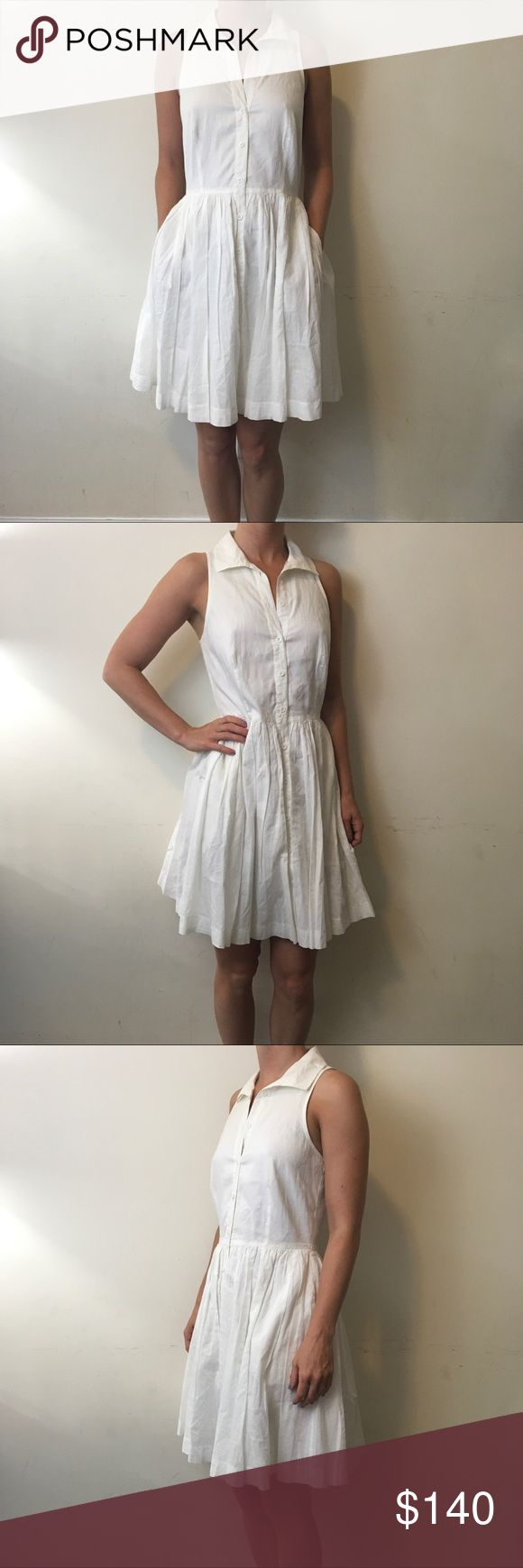 Reiss White Sleeveless Collared Button Down Dress Reiss Dress with a white body and is Sleeveless with a collar and Button Down center. Lined and worn lightly a few times. Size 2. True to size. Has some light marks along the neck - easy fix with a dry clean or hand wash :) Reiss Dresses