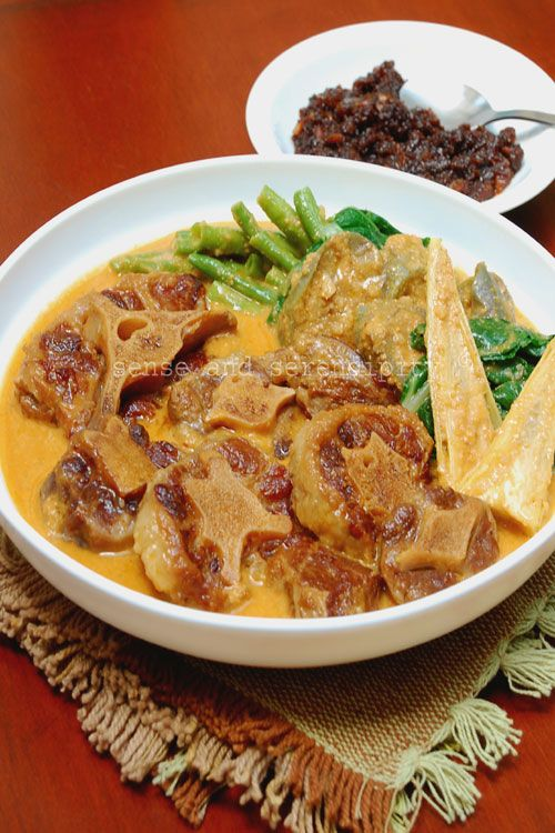 Filipino Kare Kare (Ox Tail and Peanut Stew) recipe - While this stew may seem complicated, it's not too difficult at all, especially if you cook the meat one day ahead, store in the fridge and remove the hardened fat on the surface the following day. Kare Kare should be served with bagoong, a pungent and salty condiment of fermented shrimps. #filipino #stew