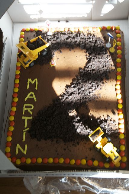Construction Theme Birthday Party, Cake ideas, we love trucks! Get a chocolate cake from costco with no decorations. Crush some oreos-removing the cream first- borrow some trucks from your little man, and decorate with colorful m&ms or other candy.