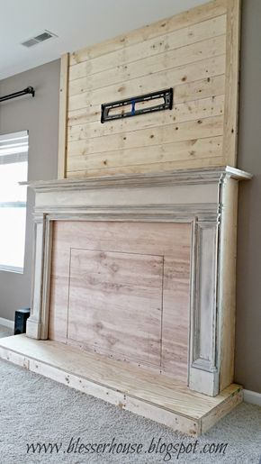 DIY faux fireplace with plank wall chimneypiece - Blesser House featured on @Remodelaholic. Could add my floor to ceiling bookcases on either side.