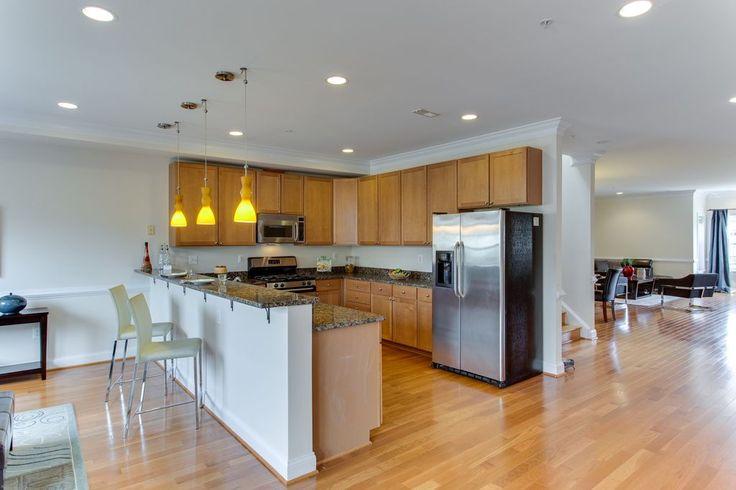Contemporary Kitchen with Kitchen peninsula, Chair rail, Simple granite counters, Giallo Atlantico Granite Countertop, Flush
