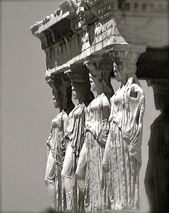 """The Erechtheion at The Acropolis, was built around 420 BC. The famous """"Porch of the Caryatids"""" or """"Porch of the Maidens"""" contains 6 beautifully ornate columns of women supporting the roof on their heads. I was mesmerized by this temple. The detail in the sculpture is amazing. Each of the 6 women are unique and feminine, with each tunic they wear are draped in a different way. — in Athens, Greece."""