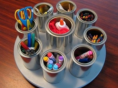 Glue tin cans to a lazy susan for the arts and crafts table. | 35 Money-Saving…