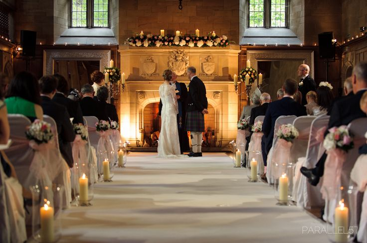 The romantic wedding ceremony in front of the grand fire place in Achnagairn House, Inverness, Scotland. Inverness is the Capital of the Highlands. Candles at Eventide this is a romantic Scottish Wedding. Photo: ivyfellenweddinginvitations.co.uk