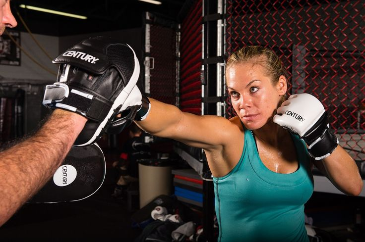 Julie Kedzie practicing her boxing with a pair of Century CREED MMA Training Gloves and Short Focus Mitts.