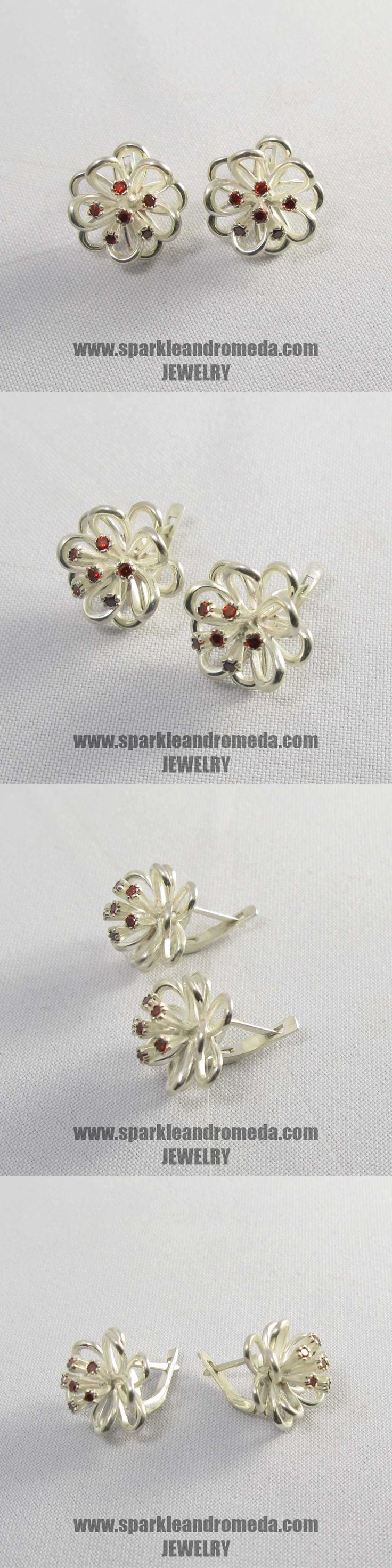 Sterling 925 silver earrings with 12 round 2 mm red almandine color cubic zirconia gemstones.