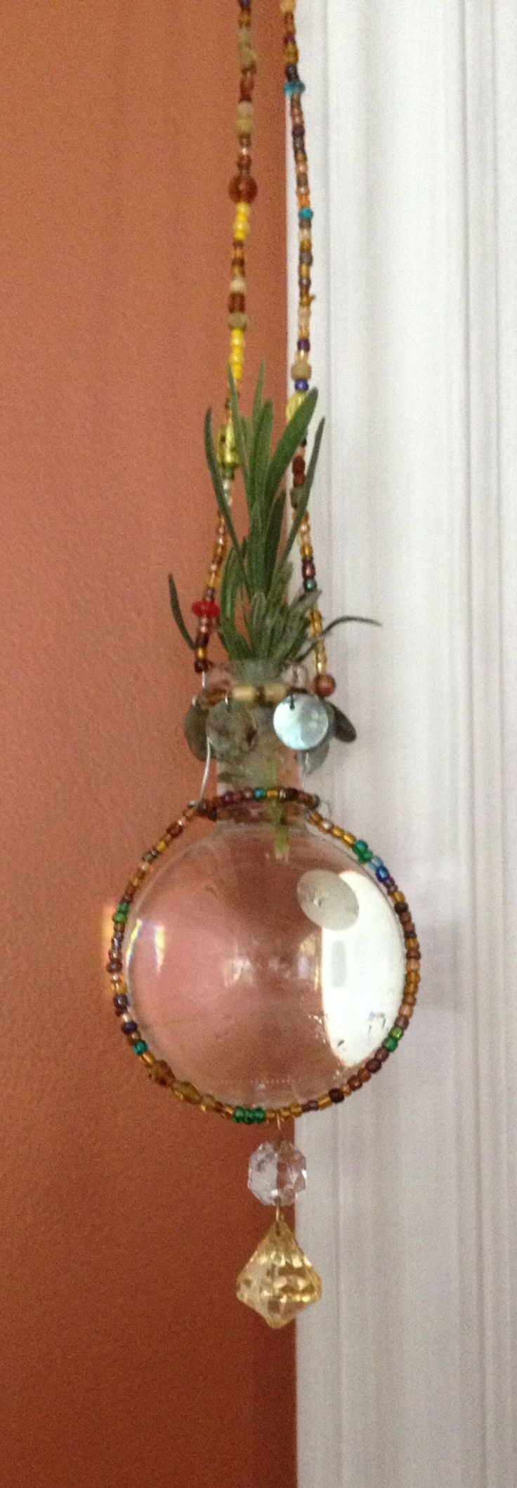 Little glass and bead hanging vase for cuttings from my garden