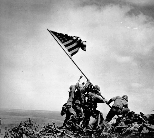 Raising the Flag on Iwo Jima is an historic photograph taken on February 23, 1945, by Joe Rosenthal. It depicts five U. S. Marines and a U.S. Navy corpsman raising the flag of the U. S. atop Mount Suribachi during the Battle of Iwo Jima in WW II.It became the only photograph to win the Pulitzer Prize for Photography in the same year as its publication, and came to be regarded in the U. S. as one of the most significant and recognizable images of the war.