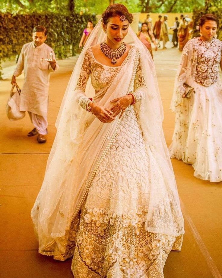 Waking up to a lehenga so gorgeous… We are loving this ivory lehenga by @shreya.rajvi of #phatphattitude with a hints of lace and pearls. #goldlehenga #embroidery #lehengalookbook #bridaljewellery...