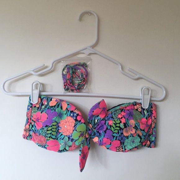 Floral Bandeau Bikini Top Strapless bandeau bikini top with floral design. Straps attach for a more secure fit. Never worn. Victoria's Secret Swim Bikinis