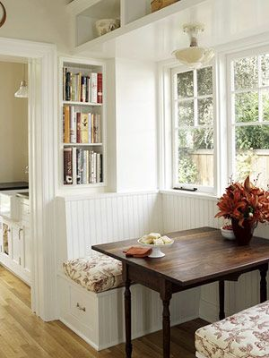 I heart this breakfast nook - I swoon for dark wood for some reason. I also love the shelves behind for books!