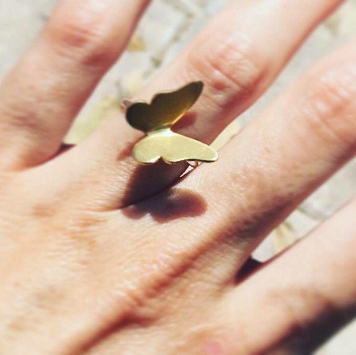 One of our clients with the butterfly ring!  Una de nuestras clientes con el anillo de mariposa!