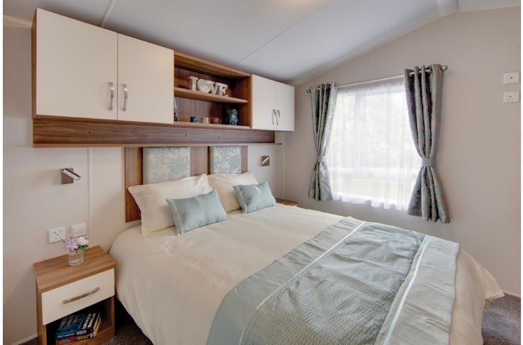 Looking for a static caravan in North Wales? The 2 bed Willerby Avonmore comes with an ensuite, PVCu patio doors & feature fireplace - Click to View Now!