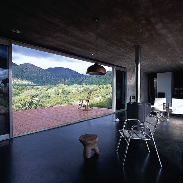 Via thehardt House in Capilla del Monte by Marchisio Nanzer located in Uritorco, Cordoba, Argentina. The 1,550 ft² (144 m²) home is set at the foot of Uritorco Hill, this stone and concrete house rises asa device through which to contemplate the changing spectacle of the mountain. It is an extremely remote location. #Argetina #Architecture #View #lighting #shadows #light #concrete