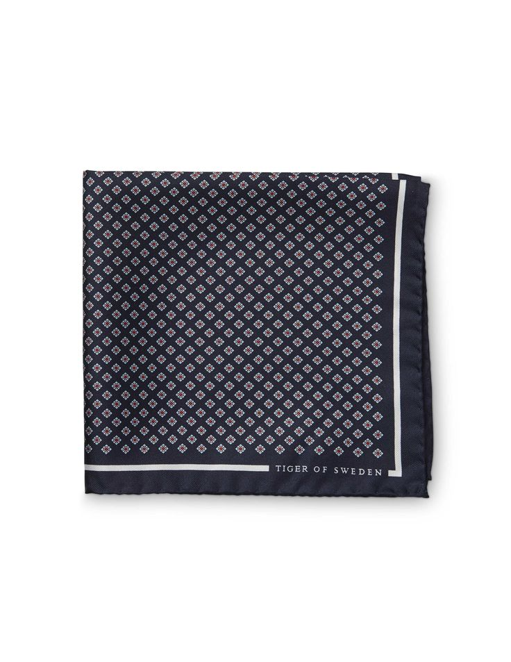 Scipello handkerchief -Men's handkerchief in pure silk twill. Features classic all-over geometric tie pattern. Solid border with Tiger of Sweden logo in one corner.