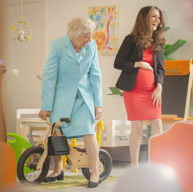 The Queen tests a baby bike as Kate gets the giggles. See, this is why the Queen is so awesome!!!!