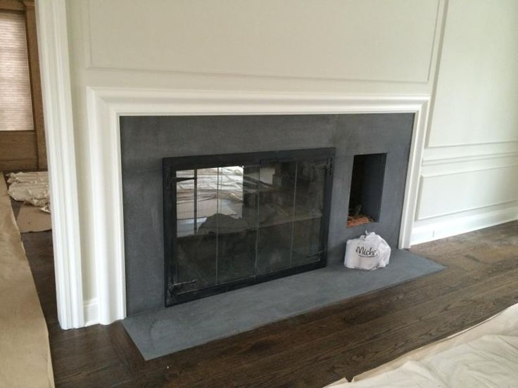 The fireplace surrounds are Flamed Finish Absolute Black Granite and Pietra Cardosa Stone. If you can't tell from the photos, the fireplace is actually a see-through fireplace visible on both sides of the wall.