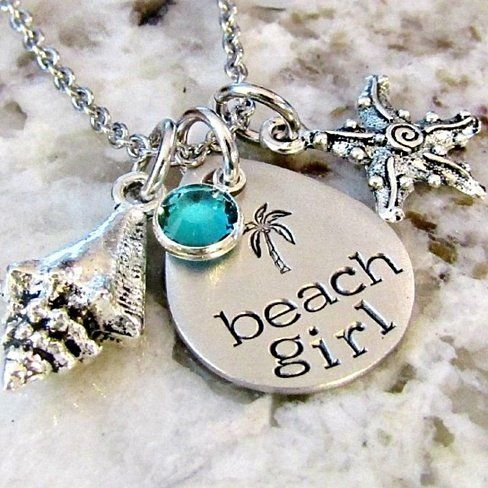 This hand-stamped stainless steel necklace is the perfect little reminder of a seaside escape. It features a beautiful aqua channel set Swarovski crystal, Tibetan silver charms and teardrop pendant. It also makes for a wonderful gift for someone who misses living by the ocean.