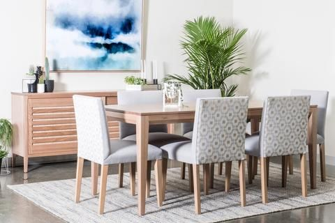 Contemporary Australian dining room furniture. Japandi style solid timber buffet and dining table with uniquely upholstered dining chairs. Made to order in Melbourne, Australia.