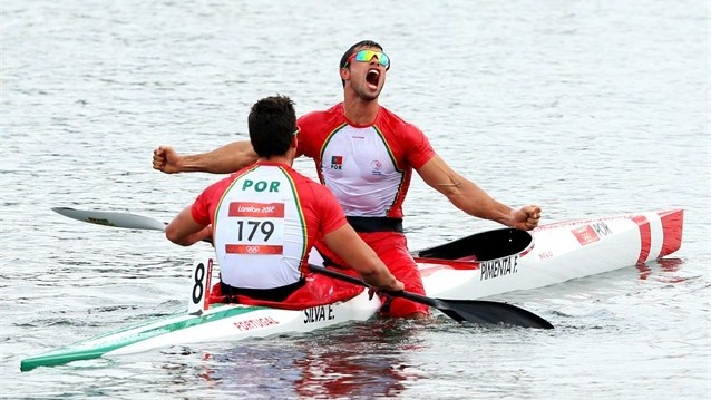 Emanuel Silva and Fernando Pimenta (R) of Portugal celebrate their silver medal during the men's Kayak Double (K2) 1000m Canoe Sprint finals on Day 12 of the London 2012 Olympic Games at Eton Dorney.