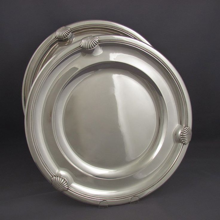 A pair of handmade French .950 silver charger plates by Boin Taburet, Paris c. 1920. Circular with molded edge...