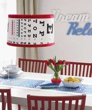 Dress up a store-bought lamp shade with an eye chart. (Click through for instructions.)