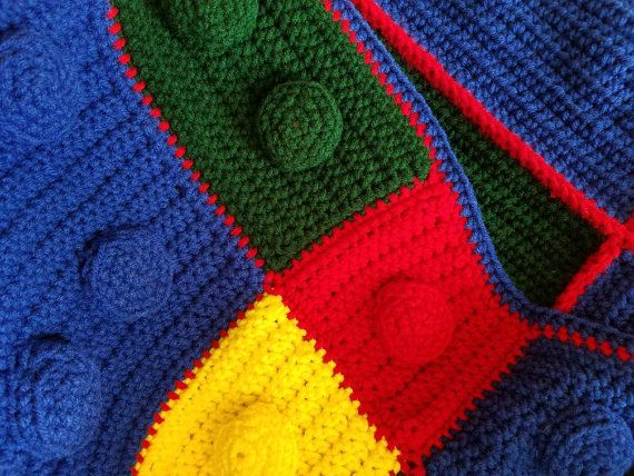 Handmade Crocheted Lego Blanket. The blanket is 44 wide and 51 long.