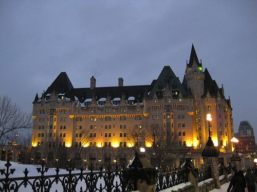 Chateau Laurier (Ottawa, ON) --- The commissioner of the castle/hotel, Charles Hays, perished on the Titanic while traveling back for initial opening in 1912. Famously claimed to now be haunted by his ghost.