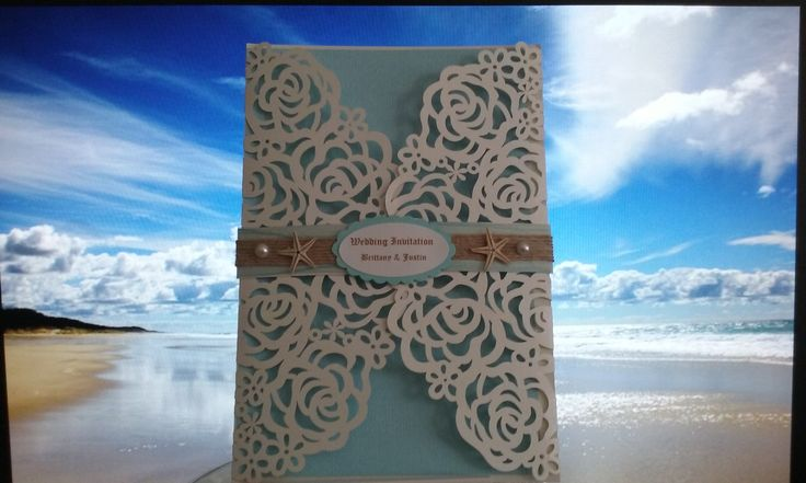 Lace gatefold with blue insert, light blue belly band decorated with twine, starfish and pearl beads.