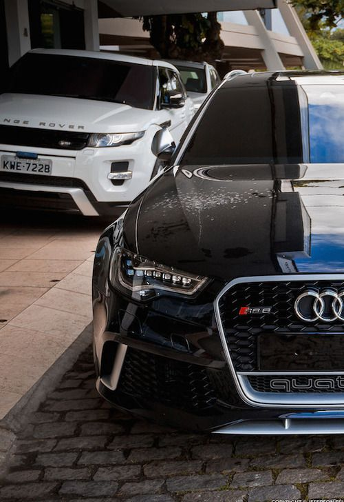 Audi RS6, with a Range Rover Sport in the background