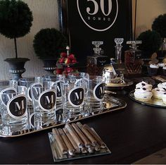 Masculine male birthday decor black white silver for a 50th birthday party.