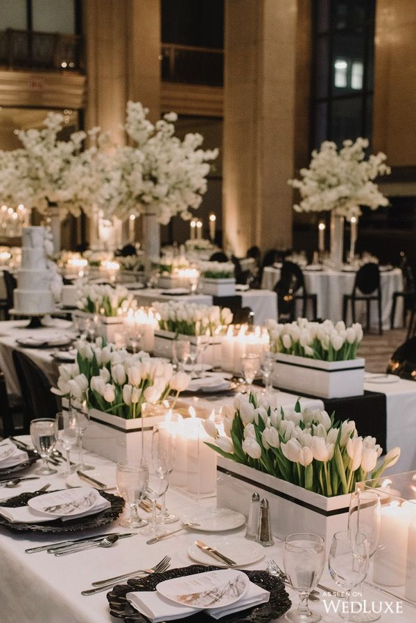 WOW! Look how lovely these white tulips are in their white boxes | Photography by: Mango Studios Follow @WedLuxe for more wedding inspiration! #white #whitewedding #tulip #whitetulips #tabledecor