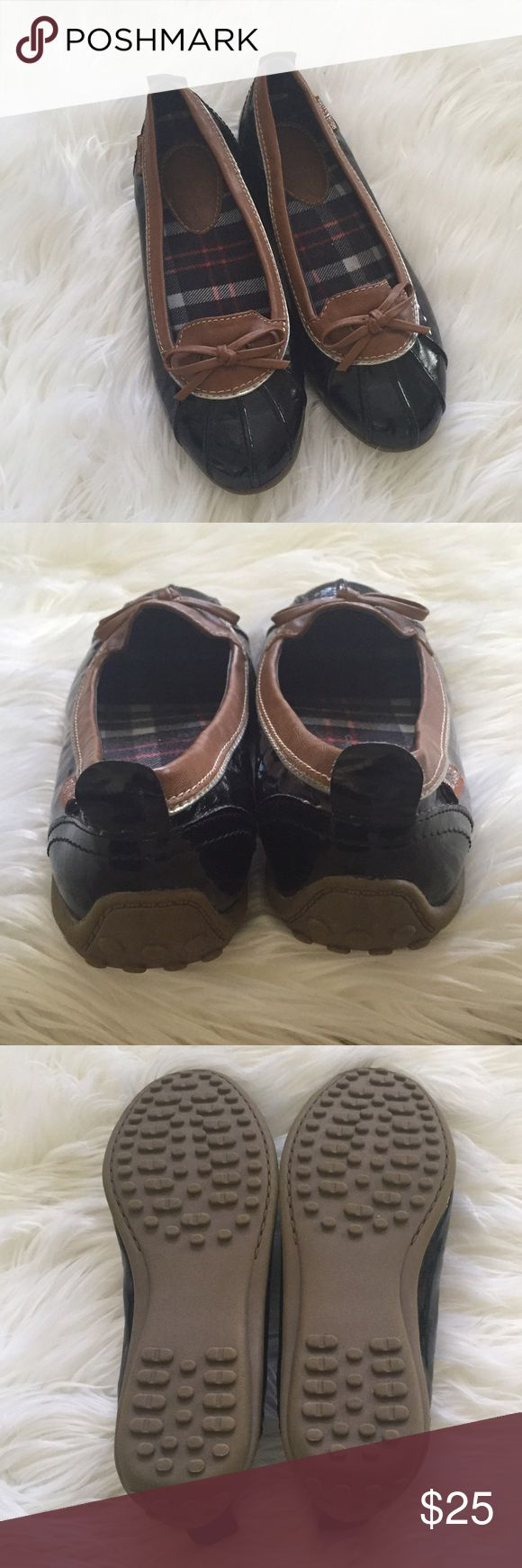 New Listing {Aqua Stop} Rain Shoes {Aqua Stop} Rain Shoes. Size: 7. Color: Black with brown trim. Never worn, in excellent condition. The perfect alternative to boots in rainy weather. Aqua Stop Shoes Flats & Loafers