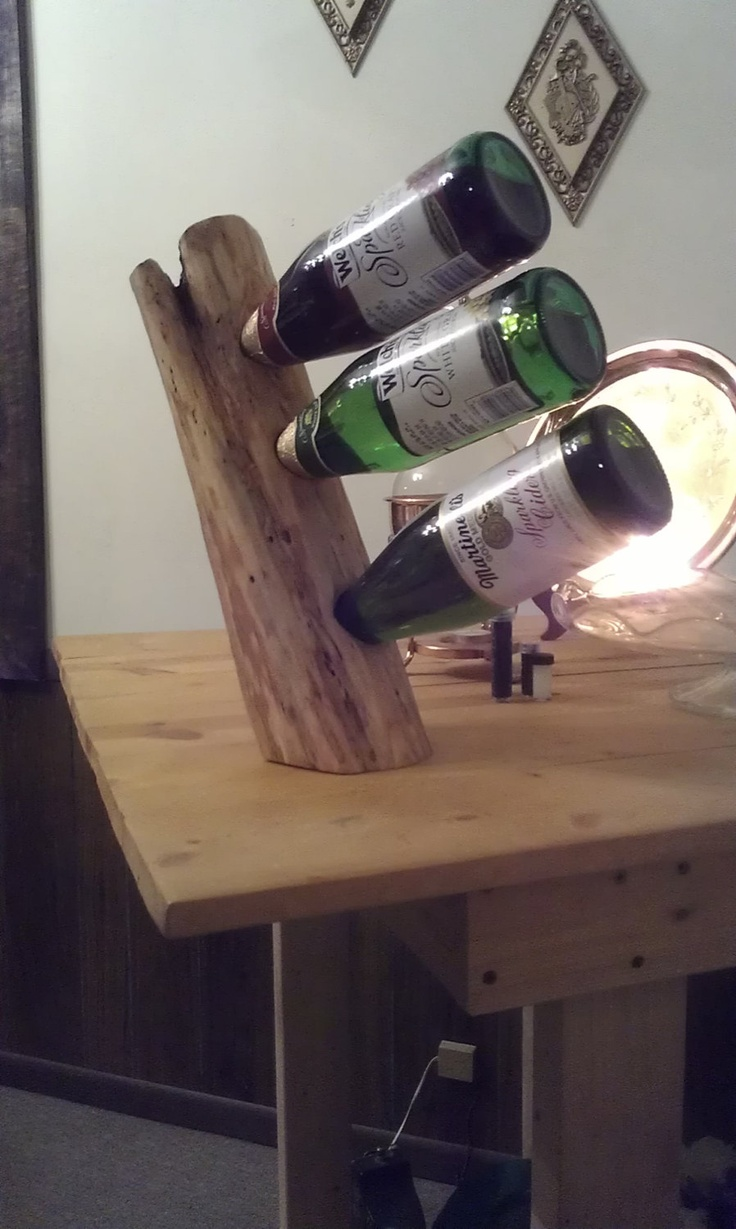 DIY Wine Holder (Holds upto 3 bottles). Who doesn't have a chunk of tree around, lol ;-)