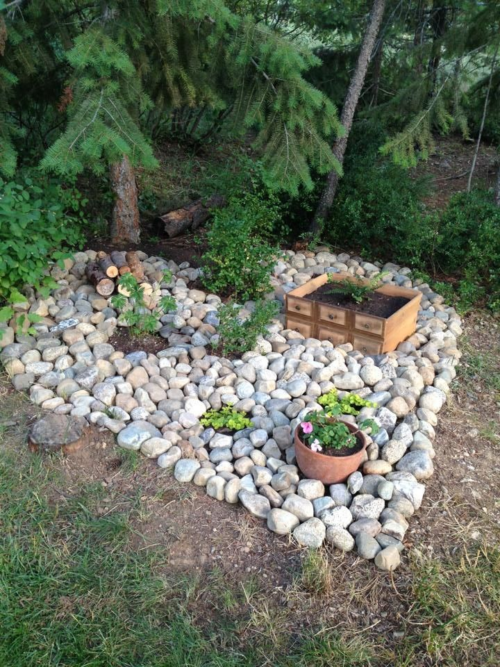 Heart-shaped feature garden made with rocks. With a little ...