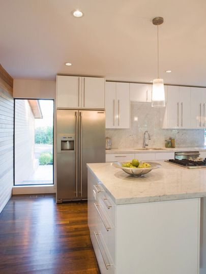 white, modern kitchen. flat cabinets, stainless steel, marble
