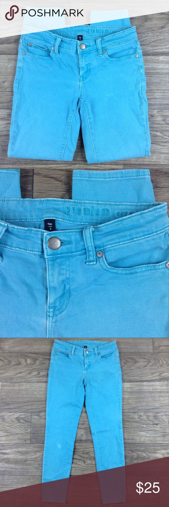 """Gap Premium Super Skinny Ankle Aqua Jeans Sz 2 Gap Premium Super Skinny Ankle Distress/Stone Wash Aqua Jeans. Sz 2 with approximate measurements of 14"""" waist, 16"""" hip, 26.5"""" inseam, and 7.5"""" rise. Pre-owned in great condition with minimal wear. Please look at all pictures and if you have any questions, leave a comment below. Thank you for looking! GAP Jeans Skinny"""